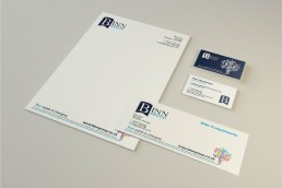 Binn Group stationery set showing branded letterhead, business cards and compliment slip